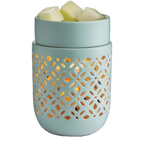 Wax Melter. Soft Mint: A precision-cut pattern allows the light to be the focal point of a soft matte finish in a refreshing mint glaze.