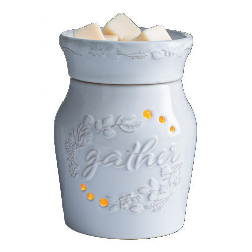 """Wax Melter. A harvest botanical motif encircles the word """"gather"""" in a soft white glaze, reminding us to focus on all the ways we gather on holidays, and every day."""
