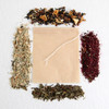 spice.boutique - four types of tea shown surrounding a teabag of unbleached paper against a white background
