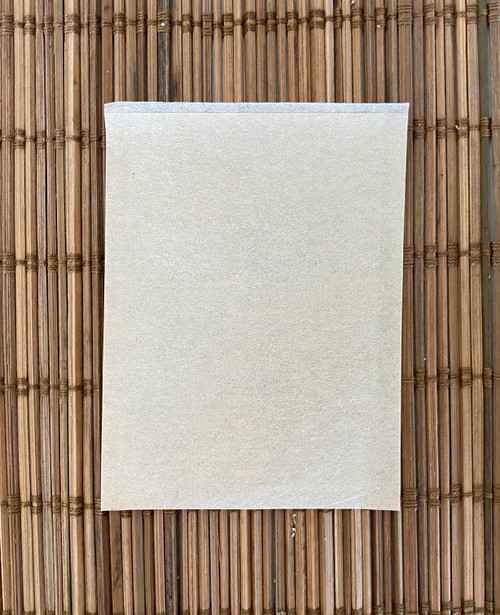 an empty brown unbleached paper self filled teabag heat seal