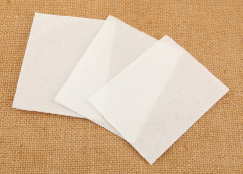 three white paper self fill teabags