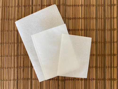 three different sizes of white paper heat sealable self fill teabags