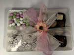 ceramic white  tray filled with chocolate and candy