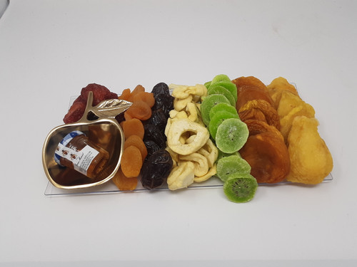 dried fruit platter with apple shaped dish and honey jar