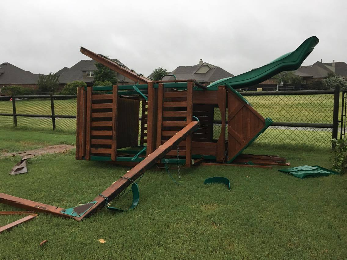 play set next to trampoline shown picked up and flipped by tornado