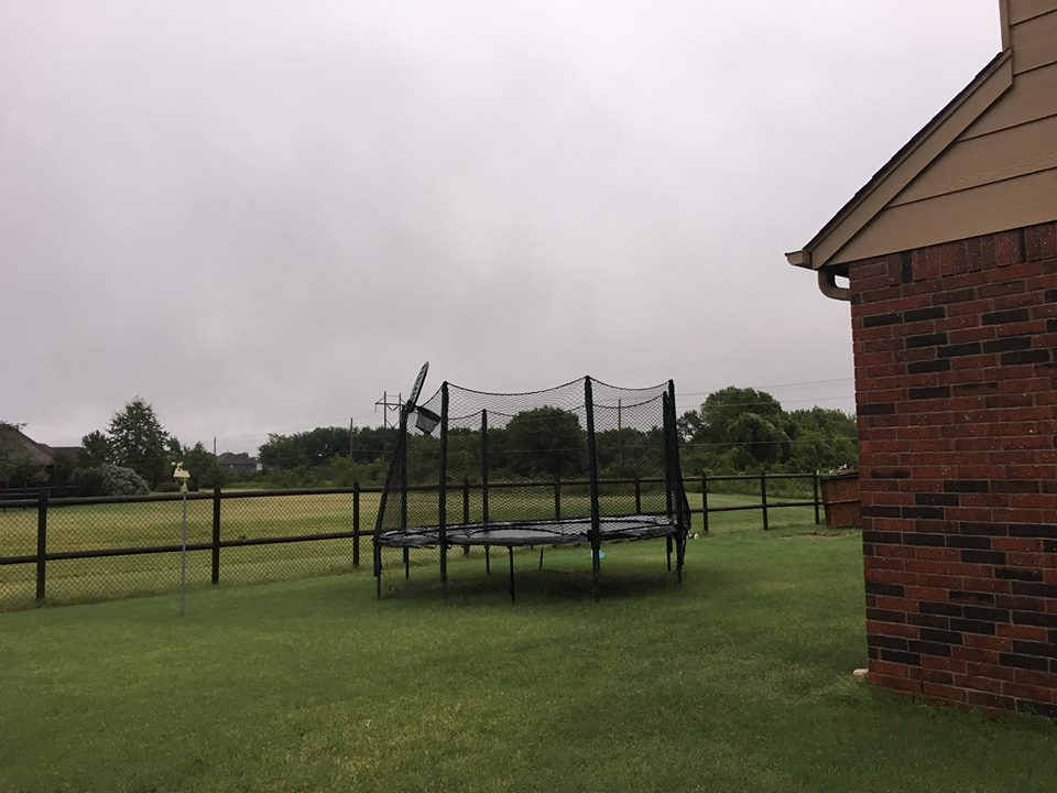 post with basketball goal bent by tornado