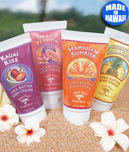 Island Soap Company Shea Butter Body Creams on display at the beach circled with white flowers
