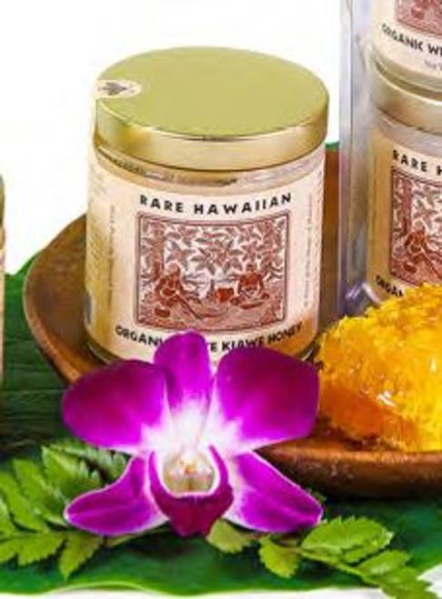 Rare Hawaiian Organic White Kiawe Honey with display honeycomb and purple flower
