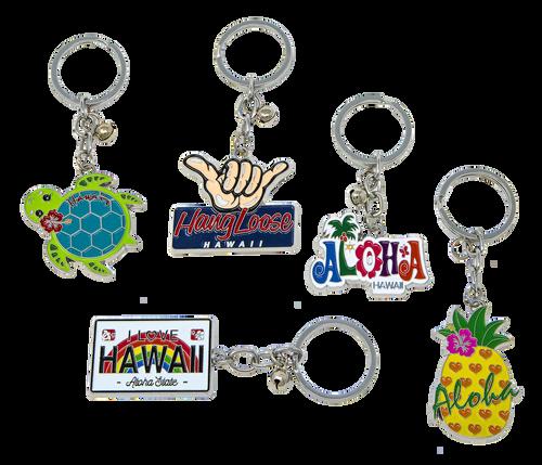 Metal Enamel Keyrings - Island Memories in the following designs: Hawaii License, Aloha Fun, Hangloose, Aloha Pineapple and Honu with Flower