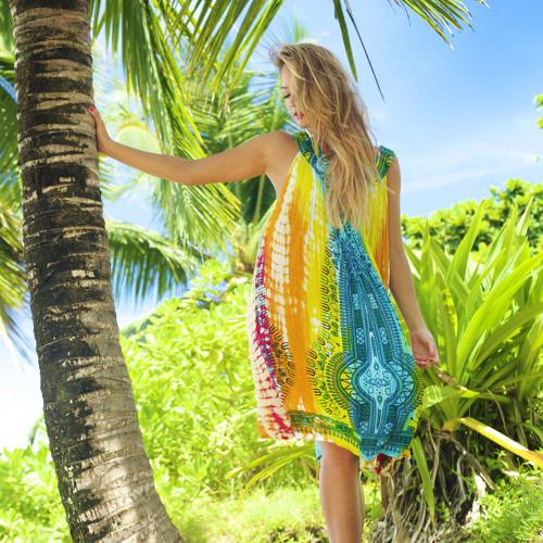 Female model wearing V-Neck Umbrella Dress in Rainbow color scheme