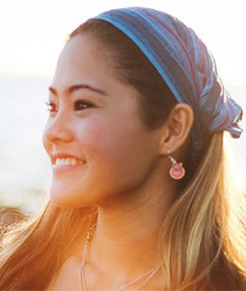 smiling girl wearing a Shanti Town Aloha Headbands in blue stripe color