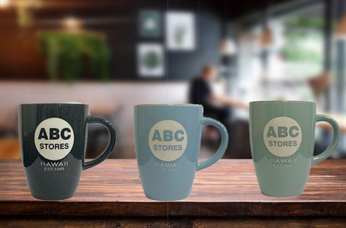 3 ABC Classic Island Collection Mugs from left to right in Dark Gray, Light Blue, or Light Green colors placed on a coffee table