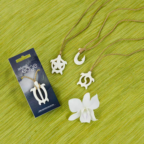 Island Edge Hand Crafted Bone Necklace designs displayed in order from left to right: Strong Honu, Plumeria Honu, Fish Hook, and Yin Yang Honu