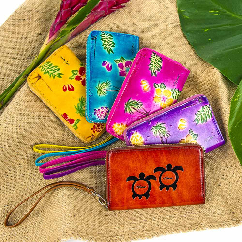 Wristlet Wallets arrayed in the following colors in clockwise order starting from the top: Yellow, Blue, Pink, Purple, and Natural Brown