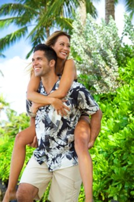 A female model riding over the shoulders of a Male model who is wearing Men's Cotton Aloha Shirt in Black with Cream Floral design