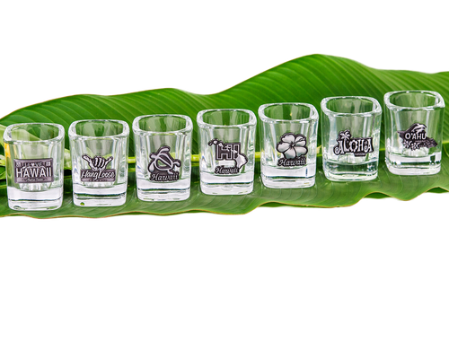 Hawaii Emblem Shotglass. Square shaped heavyweight shot glass with a 3-D pewter Hawaii emblem design