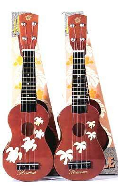 Hawaiian Standard Wooden Ukulele designs pictured from left to right: Honu and Palm Tree