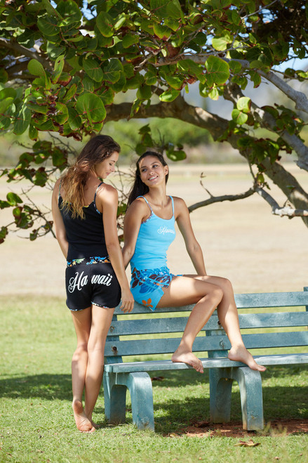 Two female models wearing Island Design - Strap Tee with Printed Trim