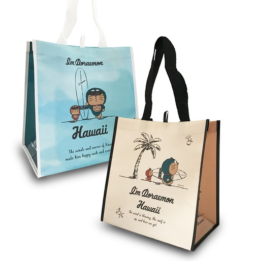 Two Doraemon® Reusable Bags, one in natural walk design with a Doraemon designed over a cream background while the other in Blue Surf design with a Doraemon designed over a blue background.
