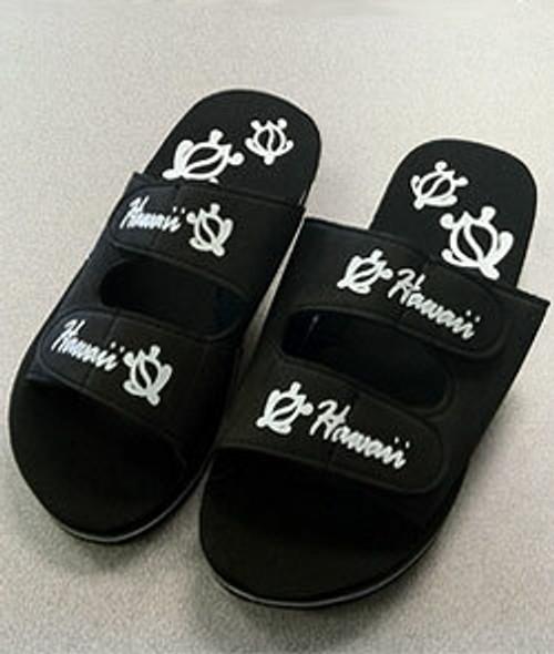 Rip-style Slip-On Sandals - black color sandal with white honu print design