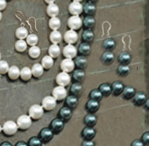 Jewel of the Sea Pearl earrings, necklaces, and bracelets on display in black and white colorings