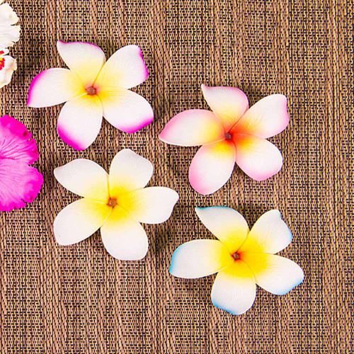Single Plumeria Clip by Olu Olu in pink, purple, blue, and white
