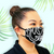model wearing Fashion Face Mask Hawaiian Design in floral assorted theme