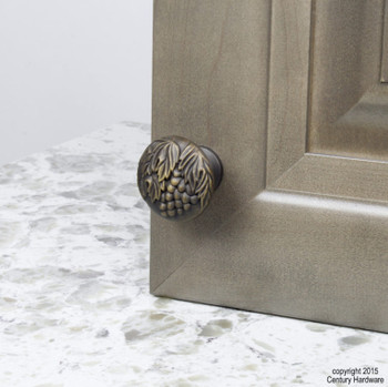 "Century, Vineyard, Premium Solid Brass 1 3/8"" Round Knob, Antique Light Brass, installed"