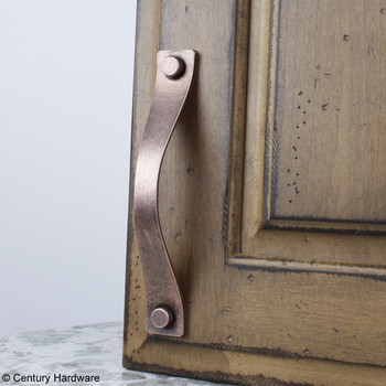 """Century, Raw Authentic, 6 5/16"""" (160mm) Zinc Die Cast Curved Pull, Aged Matte Red Copper, installed"""
