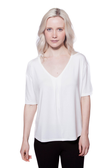 Style No: D-40  A great basic to have in your wardrobe, this ultra-soft stretchy short sleeve top can be worn alone or layered and has a relaxed fit with a gathered v-neckline. This tee is made with 100% natural fibers and is machine washable for easy cleaning and long-lasting wrinkle-free wear. Available in classic black or white. AtoZ, A to Z, basic, tee, top, vacation, travel, work