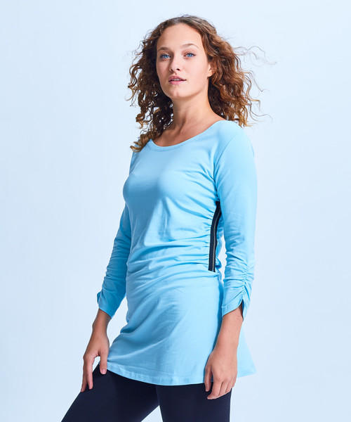 Style No. SS-CDN-30   This longer on the side side zip ruched tunic is lightweight and casual, perfect for wearing with leggings or jeans. Made with our ultra-soft cotton modal, this stretchy fabric will stay wrinkle-free so you can wear it all day long. Features roll up long sleeves, a scoop neck and an loose bottom. Machine washable for easy cleaning.