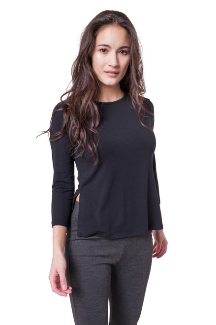Style D-72   Showcase your casual street style with this cute modal tee. Designed with comfort in mind, this cropped top is made from fine Turkish modal for increased breath-ability. With side slit, this top looks great with jeans or leggings. The blouse is machine washable for easy cleaning, and it retains its shape after each wash to ensure it always fits. Features side slit on both side seams, 3/4 sleeves and a crew neckline. Model wears a size small.