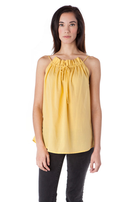 Style No. BN-117  Our delicately ruffled tank top is a feminine and effortless choice for spring or summer. Wear with your favorite pair of jeans, shorts or cropped pants and fun jewelry. This breezy tank can easily be dressed up or down depending on your mood. Made with airy cotton voile fabric for an all-day breathable comfort. Features a thin, adjustable drawstring neckline and loose fit. Machine wash with warm or cool water, and hang dry for the best wrinkle-free results.