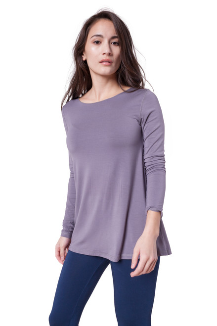 Style D-11  A great A-line, flared basic to have in your wardrobe, this ultra-soft stretchy long sleeve top can be worn alone or layered with your favorite cardigan or scarf. The classic crew neckline and lightweight Modal material make this a favorite staple piece among many of our customers. This tee is made with 100% natural fibers and is machine washable for easy cleaning and long-lasting wrinkle-free wear