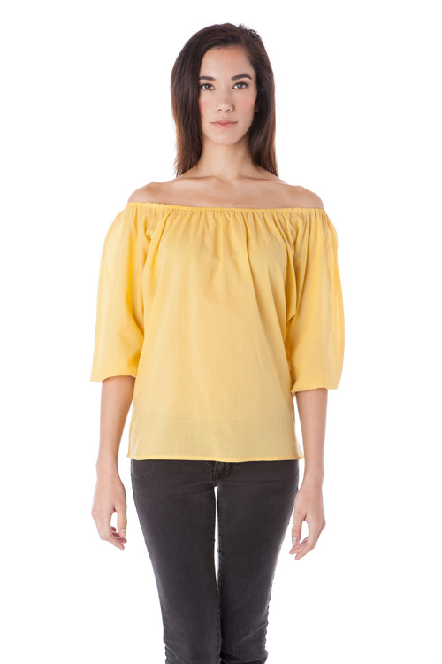 Style BN-114  Our loose off-the-shoulder peasant top is a feminine and effortless choice for spring or summer. Wear with your favorite pair of jeans or cropped pants and jewelry. This cool blouse can easily be dressed up or down depending on your mood. Made with airy cotton voile fabric for an all-day breathable comfort. Features elastic with shirring at the neckline and wrists. Machine wash with warm or cool water, and hang dry for the best wrinkle-free results. AtoZ, A to Z, basic, blouse, top, travel, vacation, work