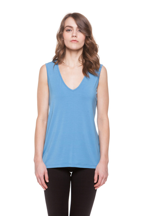 Style D-63   Wear our classic, v-neck sleeveless tank top with jeans and sandals to create a casual wardrobe that transitions from lounging at home to running errands seamlessly. This soft modal top has a modern look with a relaxed fit. Machine washable for easy cleaning, this tank is a timeless piece of clothing to add to your wardrobe. 95% modal, 5% elastane. Hang dry for best results. AtoZ, A to Z, basic, sleeveless, shell, tank, tee, top, work, vacation, travel