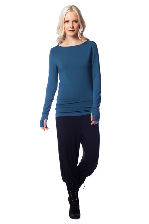 Style No. D-34  A great basic to have in your wardrobe, this ultra-soft stretchy long sleeve top has an elegant boat neckline and thumbholes. The classic crew neckline and lightweight cotton material make this an easy layering piece or a stand-alone favorite. This tee is made with 100% natural fibers and is machine washable for easy cleaning and long-lasting wrinkle-free wear. Available in 5 flattering colors so you can find the perfect match for your style. 95% modal 5% elastane. AtoZ, A to Z, basic, tee, top, thump hole, travel, yoga, work