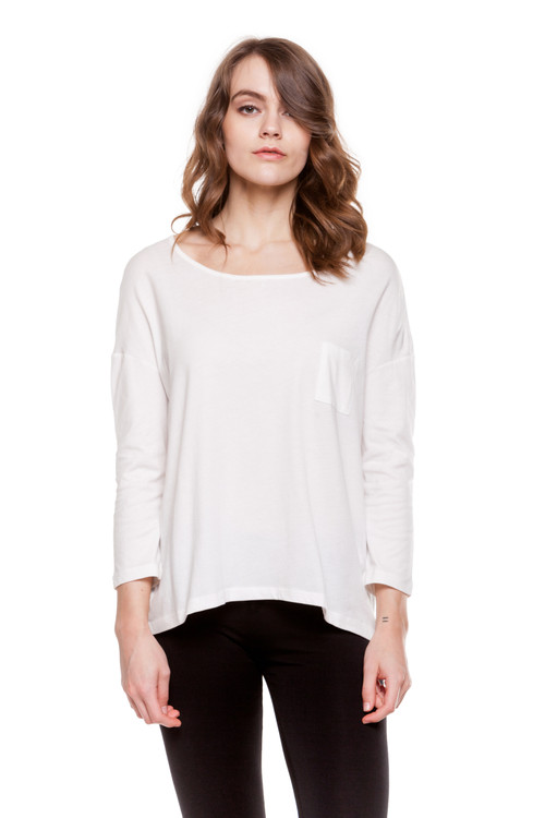 Style B-56 Showcase your casual street style with this cute cotton tee. Designed with comfort in mind, this blouse is made from fine Turkish cotton for increased breath-ability. With a longer hem in the back and a loose fit, this top looks great with jeans or leggings. The blouse is machine washable for easy cleaning, and it retains its shape after each wash to ensure it always fits. Features a front left pocket, 3/4 sleeves and a scoop neckline.