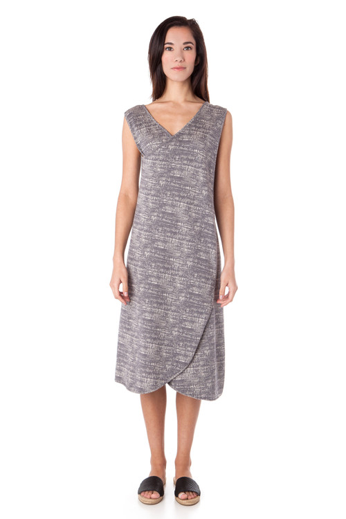 Style RD-8  Our textured knit apron dress features wide straps, a crossed front and unique petal-like draping. Wear with a natural accessories like a wooden necklace and slip on flats for a truly unique look. Made with our comfortable textured knit fabric in a pretty blend of Charcoal and Fog. Machine washable and wrinkle-free. Hang dry for best results.