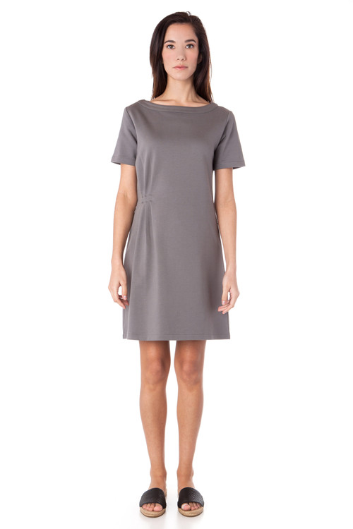 Style No. ED-7 This comfortable yet playful dress is made with 100% 2-ply Turkish cotton. A simple silhouette with short sleeves and a just-above-the-knee length, you can wear this dress in a number of ways. Dress up with wedges and a bold necklace or pair it with sandals and a messy bun. The relaxed fit will make you want to wear this all day and the side pleats add a bit on interest to this versatile dress. Machine washable and wrinkle-free.