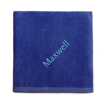 Personalized embroidered royal blue beach towel
