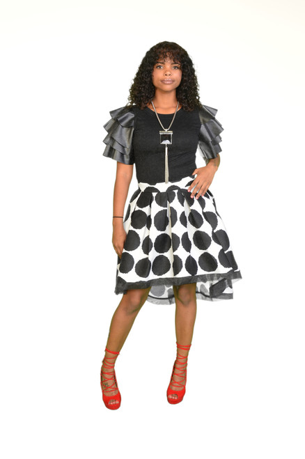 Black and White pocky Dot Asymmetric Skirt Dressed up with Black Casual top. Top available also.