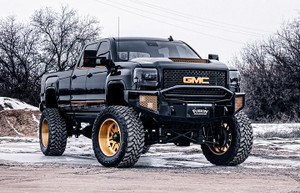 """Gladiator Edition with a pre-runner bar, Rigid Industries Dually XL fogs, and a custom SR LED bar. 22x12 American Force Wheels, 37"""" Toyo MT's, and a 7-9 Cognito lift."""