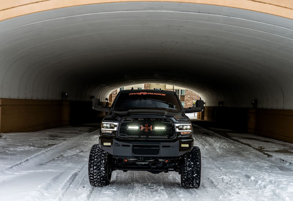 """6"""" Rigid E-Series as fog lights.  Hole/mounts for a 20"""" single row LED over the vent.  Parking sensors. Center vent with stainless steel mesh insert"""