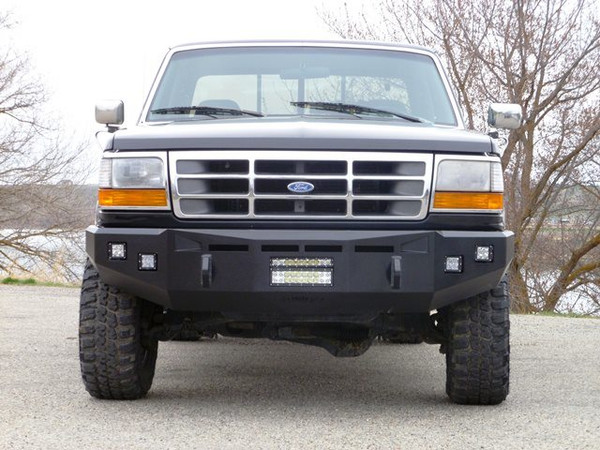 """Base Bumper. Clevis Mounts. 3"""" Cube Light Mounts. Rigid Industries: 10"""" SR over a 10"""" E-Series in the License Place Area"""
