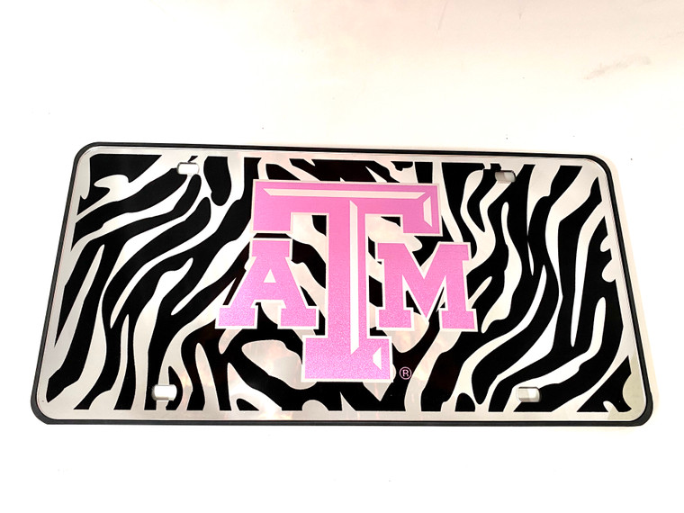 Zebra and reflective Texas A&M license plate.
