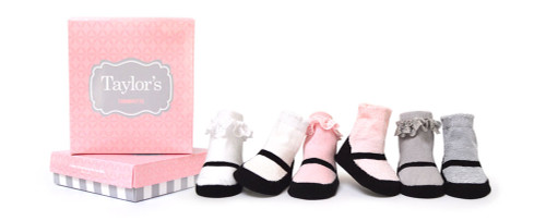 Six pairs of girls socks for babies, infants and toddlers ages 0 - 12 months.  Baby socks come in white, pink and grey.