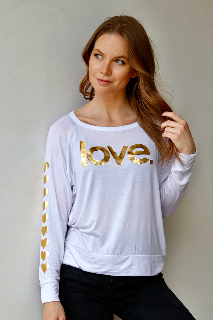 GOLD FOIL LOVE. L/S TEE with a HEARTS GRAPHIC IN GOLD FOIL on ARM (White)