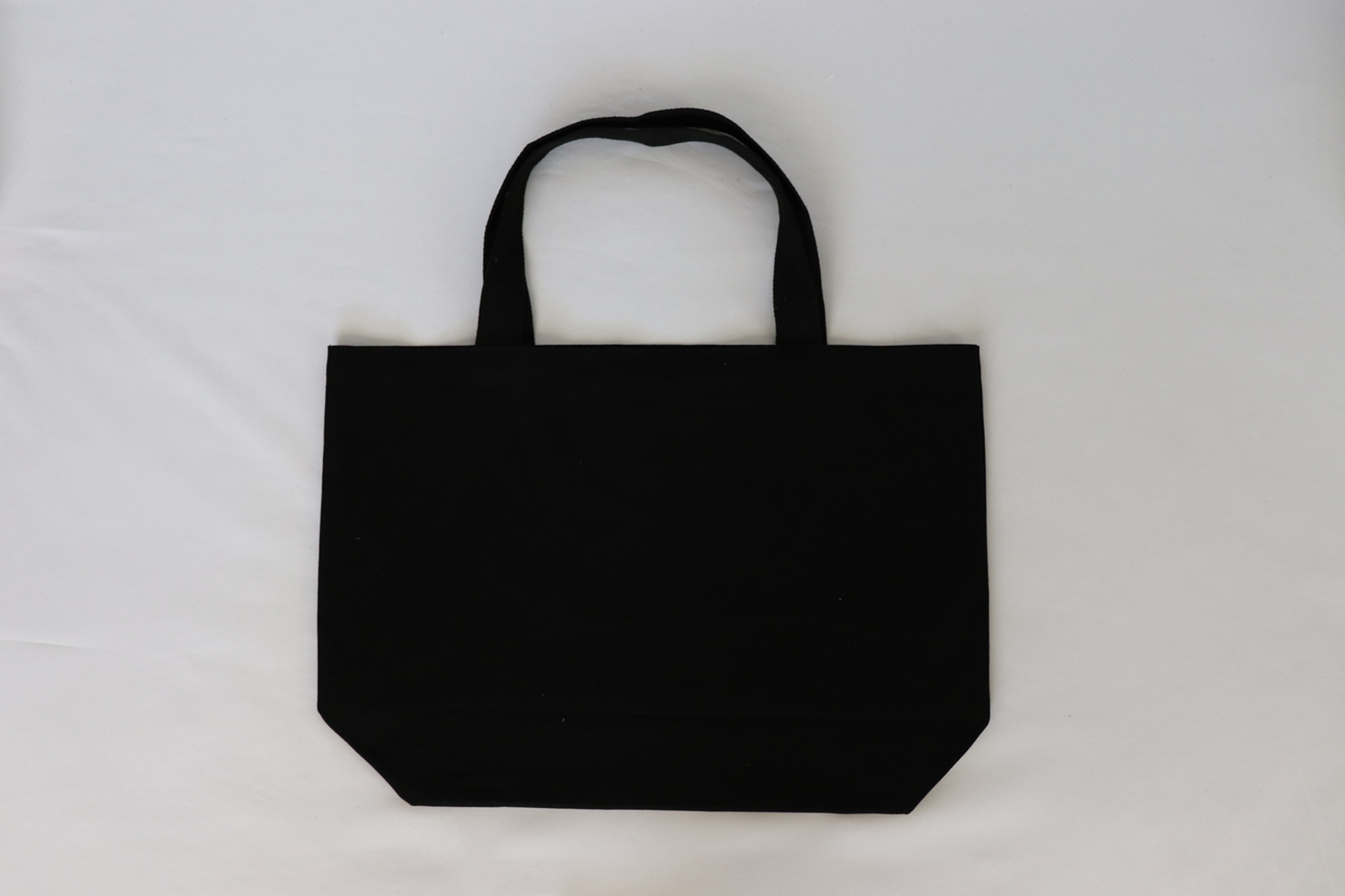 HEART SPLATTER BLACK CANVAS TOTE with solid back.