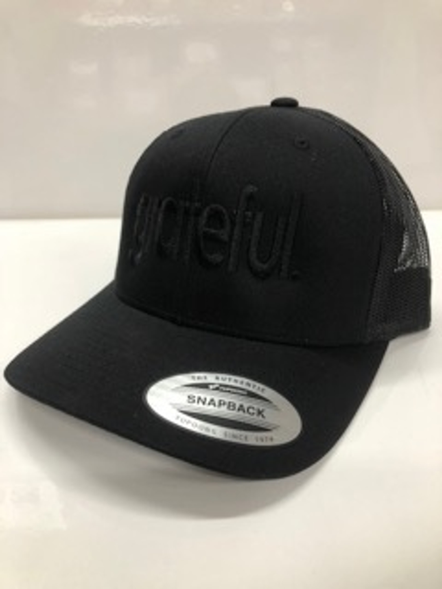 GRATEFUL. EMBROIDERED TRUCKER HAT BLACK ON BLACK